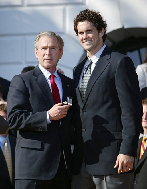 President George W. Bush greets Matt Leinart of University of Southern California's football team during a visit by the 2003 Fall NCAA Championship teams on the South Lawn March 23, 2004. In attendance were the University of Southern California's football and women's volleyball teams, the University of North Carolina women's soccer team, Louisiana State University football team and Indiana University men's soccer team. White House photo by Paul Morse.