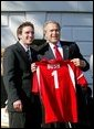 President George W. Bush greets Drew Shinaberger of Indiana University's men's soccer team during a visit by the 2003 Fall NCAA Championship teams on the South Lawn March 23, 2004. In attendance were the University of Southern California's football and women's volleyball teams, the University of North Carolina women's soccer team, Louisiana State University football team and Indiana University men's soccer team. White House photo by Paul Morse.