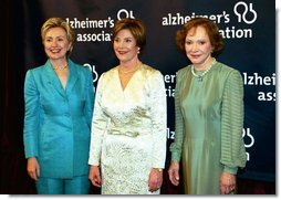 "Accompanied by former first ladies Sen. Hillary Rodham Clinton, left, and Rosalynn Carter, Laura Bush attends the inaugural gala for the Alzheimer's Association in Washington, D.C., Wednesday, March 24, 2004. ""I know how hard it is to lose someone to Alzheimer's disease. I lost my father seven years ago, so this subject is never far from my heart,"" said Mrs. Bush in her remarks.  White House photo by Tina Hager"