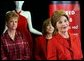 During a trip to Chicago, Mrs. Bush discusses the Red Dress Project Tuesday, March 23, 2004. Behind Mrs. Bush are dresses designed by American fashion designers which are touring the country to raise awareness of heart disease in women. White House photo by Tina Hager.
