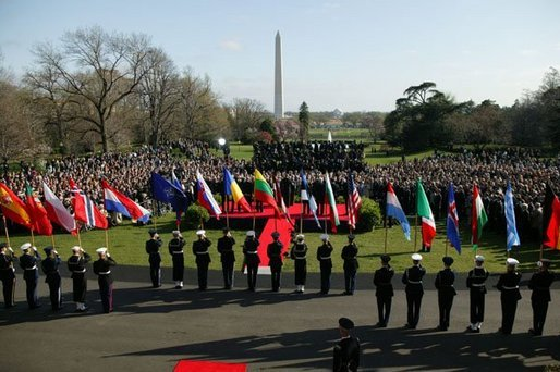 President George W. Bush addresses a crowd gathered on the South Lawn to celebrate the induction of seven countries into NATO Monday, March 29, 2004. The countries acceding to the alliance are Latvia, Slovenia, Lithuania, the Slovak Republic, Romania, Bulgaria and Estonia. White House photo by Susan Sterner