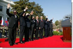 President George W. Bush waves with Prime Ministers of seven countries after a South Lawn ceremony welcoming them into NATO Monday, March 29, 2004. From left are: Prime Minister Indulis Emsis of Latvia, Prime Minister Anton Rop of Slovenia, Prime Minister Algirdas Brazauskas of Lithuania, Prime Minister Mikulas Dzurinda of the Slovak Republic, President George W. Bush, Prime Minister Adrian Nastase of Romania, Prime Minister Simeon Saxe-Coburg Gotha of Bulgaria, Prime Minister Juhan Parts of Estonia, and NATO Secretary General Jaap de Hoop Scheffer.  White House photo by Susan Sterner