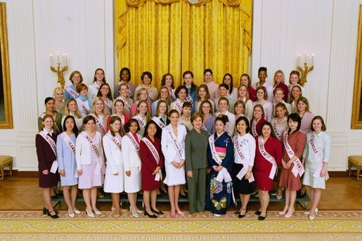 Mrs. Laura Bush poses with the 2004 Cherry Blossom Princesses in the East Room Wednesday, March 31, 2004. White House photo by Paul Morse.