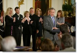 President George W. Bush speaks before signing H.R. 1997, the Unborn Victims of Violence Act of 2004, in the East Room Thursday, April 1, 2004.  White House photo by Paul Morse