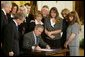 President George W. Bush signs H.R. 1997, the Unborn Victims of Violence Act of 2004, in the East Room Thursday, April 1, 2004. The legislation makes it a crime to harm an unborn child during an assault on a pregnant woman. Pictured are, from left: Sen. Mike DeWine, Sen. Orrin Hatch, Rep. Melissa Hart, Carol Lyons, Buford Lyons, Sharon Rocha, Ron Grantski, Tracy Marciniak-Seavers, Cynthia Warner, and Stephanie Alberts. White House photo by Paul Morse