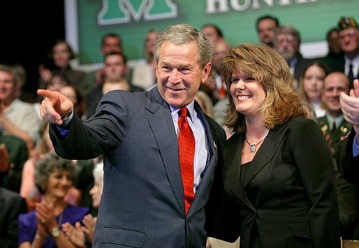 President George W. Bush acknowledges the family of stage participant and student Rina Angus during a conversation on job training at Marshall Community & Technical College in Huntington, W.Va., Friday, April 2, 2004. White House photo by Eric Draper