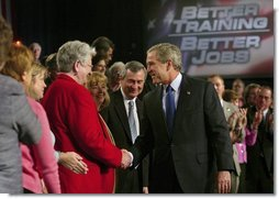 President George W. Bush greets the audience after his remarks on job training and the economy at Central Piedmont Community College in Charlotte, N.C., Monday, April 5, 2004.  White House photo by Eric Draper