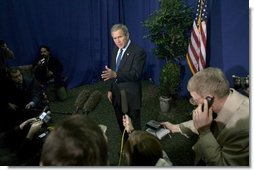 President George W. Bush speaks to the White House Press Pool in Charlotte, N.C., Monday, April 5, 2004.  White House photo by Eric Draper
