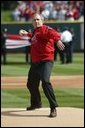 President George W. Bush throws out the first pitch during the St. Louis Cardinals' season opener against the Milwaukee Brewers at Busch Stadium in St. Louis, Mo., Monday, April 5, 2004. White House photo by Eric Draper