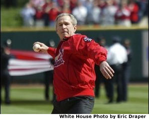 President George W. Bush throws out the first pitch during the St. Louis Cardinals. season opener against the Milwaukee Brewers at Busch Stadium in St. Louis, Mo., Monday, April 5, 2004.