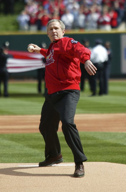 President George W. Bush throws out the first pitch during the St. Louis Cardinals' season opener against the Milwaukee Brewers at Busch Stadium in St. Louis, Mo., Monday, April 5, 2004. White House photo by Eric Draper.