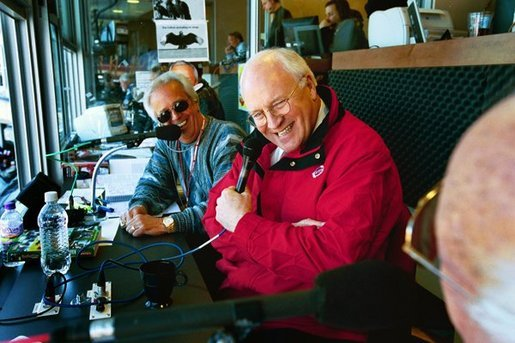 Vice President Dick Cheney talks with WLW-AM radio hosts after throwing out the first pitch on opening day in Cincinnati, Ohio at the Red's Great American Ballpark on April 5, 2004. White House photo by David Bohrer