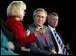 President George W. Bush listens to Dr. Kathy Matlock during a conversation on job training and the economy at South Arkansas Community College in El Dorado, Ark., Tuesday, April 6, 2004. Dr. Matlock is the President of South Arkansas Community College. White House photo by Eric Draper