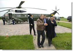 President George W. Bush escorts President Hosni Mubarak of Egypt after his arrival at the Bush Ranch in Crawford, Texas, Monday, April 12, 2004.  White House photo by Eric Draper