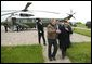 President George W. Bush escorts President Hosni Mubarak of Egypt after his arrival at the Bush Ranch in Crawford, Texas, Monday, April 12, 2004. White House photo by Eric Draper.