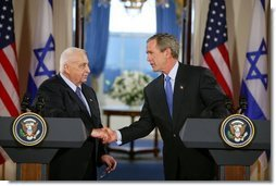 President George W. Bush and Israeli Prime Minister Ariel Sharon during a press conference in the Cross Hall of the White House on April 14, 2004.   White House photo by Paul Morse