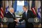 President George W. Bush and Israeli Prime Minister Ariel Sharon during a press conference in the Cross Hall of the White House on April 14, 2004. White House photo by Paul Morse.