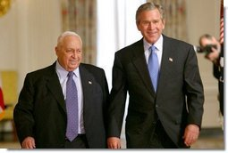 President George W. Bush and Israeli Prime Minister Ariel Sharon prior to talking with the press in the Cross Hall of the White House on April 14, 2004.  White House photo by Paul Morse