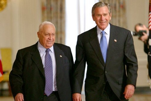 President George W. Bush and Israeli Prime Minister Ariel Sharon prior to talking with the press in the Cross Hall of the White House on April 14, 2004. White House photo by Paul Morse.