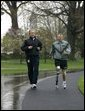 President George W. Bush runs with U.S. Army Staff Sergeant Michael McNaughton, of Denham Springs, La., on the South Lawn of the White House Wednesday, April 14, 2004. The two met January 17, 2003, at Walter Reed Army Medical Center, where SSgt. McNaughton was recovering from wounds sustained in Afghanistan. The President then wished SSgt. McNaughton a speedy recovery so that they might run together in the future. White House photo by Eric Draper.