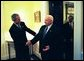 President George W. Bush welcomes Prime Minister Ariel Sharon of Israel to the White House Wednesday, April 14, 2004. The two leaders met in the residence before holding a joint press conference. Pictured behind the Prime Minister is U.S. Department of State Chief of Protocol Donald Ensenat. White House photo by Eric Draper.