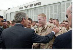 President George W. Bush talks with Robert Jackson of the 186th Military Police Company at the Iowa Air National Guard Base in Des Moines, Iowa, Thursday, April 15, 2004. Jackson was injured while serving in Iraq.  White House photo by Paul Morse