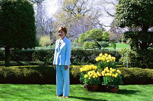 "Laura Bush hosts a press preview of the White House Spring Garden Tour in the Jacqueline Kennedy Garden Friday morning, April 16, 2004. ""I love this garden. I think the First Lady's Garden, Jacqueline Kennedy's Garden is so lovely,"" said Mrs. Bush to the press. ""I particularly love the pavilion. And when the vines on top are thick, it's a shady spot to sit."" The tour is open to the public Saturday and Sunday. Free, timed tickets are available at the Ellipse Visitor Pavilion located at 15th and E Streets on both tour days beginning at 7:30 a.m. White House photo by Susan Sterner"