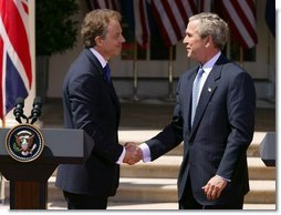 President George W. Bush and Prime Minister Tony Blair shake hands after a press conference in the Rose Garden of the White House on April 16, 2004.  White House photo by Paul Morse