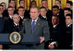 President George W. Bush speaks during the presentation of the Commander-In-Chief Trophy to the U.S. Naval Academy football team in the East Room Monday, April 19, 2004. The trophy is awarded to the Service Academy with the year's best overall record in NCAA football games versus the other academies.  White House photo by Tina Hager