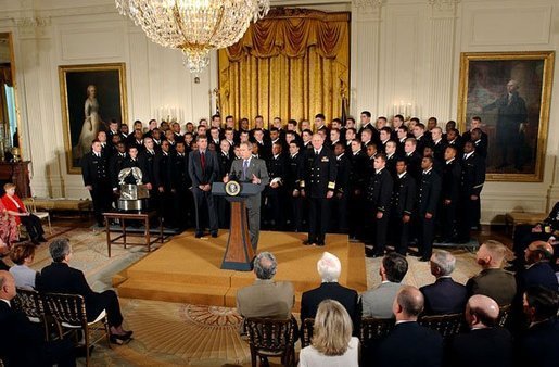 President George W. Bush speaks during the presentation of the Commander-In-Chief Trophy to the U.S. Naval Academy football team in the East Room Monday, April 19, 2004. The trophy is awarded to the Service Academy with the year's best overall record in NCAA football games versus the other academies. White House photo by Tina Hager.