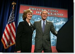 President George W. Bush is introduced by Donna Mindeck, First Vice President of the Pennsylvania State Association of Town Supervisors, before giving remarks on the USA Patriot Act in Hershey, Pa., Monday, April 19, 2004.  White House photo by Paul Morse