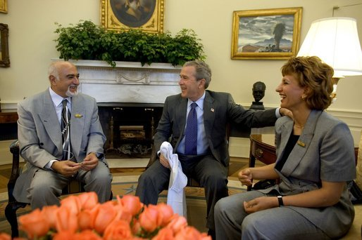 President George W. Bush meets with the newly-elected President of the National Olympic Committee of Iraq, Ahmed Al-Samarrai, left, and Dr. Iman Sabeeh, member of the Executive Office of the NOCI, in the Oval Office Monday, April 19, 2004. White House photo by Eric Draper.