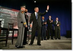 President George W. Bush waves to the audience during a conversation on the USA Patriot Act in Buffalo, N.Y., Tuesday, April 20, 2004.  White House photo by Eric Draper