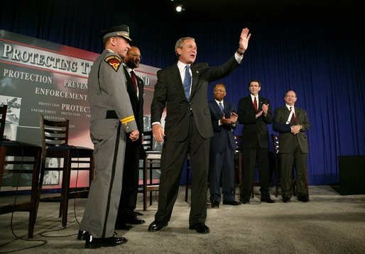 President George W. Bush waves to the audience during a conversation on the USA Patriot Act in Buffalo, N.Y., Tuesday, April 20, 2004. White House photo by Eric Draper.