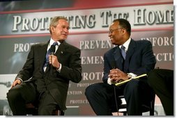 "President George W. Bush thanks Larry Thompson, former Deputy Attorney General of the United States, for his service during a conversation on the USA Patriot Act in Buffalo, N.Y., Tuesday, April 20, 2004. ""The Patriot Act needs to be renewed and the Patriot Act needs to be enhanced,"" said the President of the act that is due to expire next year.  White House photo by Eric Draper"