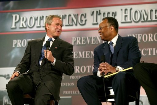 "President George W. Bush thanks Larry Thompson, former Deputy Attorney General of the United States, for his service during a conversation on the USA Patriot Act in Buffalo, N.Y., Tuesday, April 20, 2004. ""The Patriot Act needs to be renewed and the Patriot Act needs to be enhanced,"" said the President of the act that is due to expire next year. White House photo by Eric Draper."