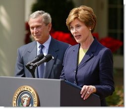 President George W. Bush and First Lady Mrs. Laura Bush at the 2004 Teacher of the Year award program in the Rose Garden of the White House on April 21, 2004.  White House photo by Paul Morse