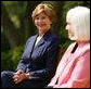 First Lady Mrs. Laura Bush with Kathleen Mellor the 2004 Teacher of the Year from South Kingstown, Rhode Island in the Rose Garden of the White House on April 21, 2004. White House photo by Paul Morse