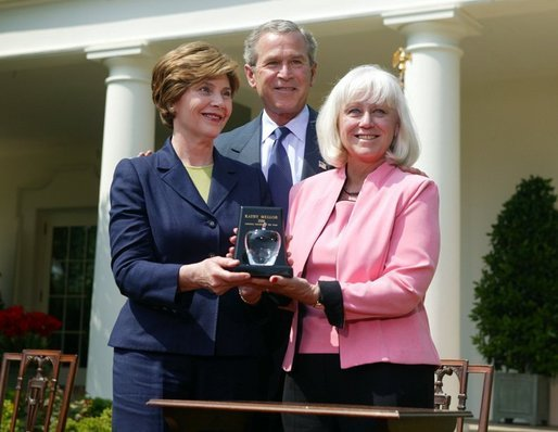 President George W. Bush and First Lady Mrs. Laura Bush with Kathleen Mellor the 2004 Teacher of the Year from South Kingstown, Rhode Island in the Rose Garden of the White House on April 21, 2004. White House photo by Paul Morse