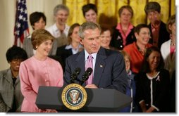 President George W. Bush gives remarks with First Lady Mrs. Laura Bush at a reception for the National Race for the Cure in the East Room of the White House on April 21, 2004.  White House photo by Paul Morse