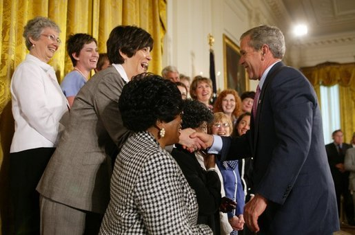 President George W. Bush greets breast cancer survivors at a reception for the National Race for the Cure in the East Room of the White House on April 21, 2004. White House photo by Paul Morse