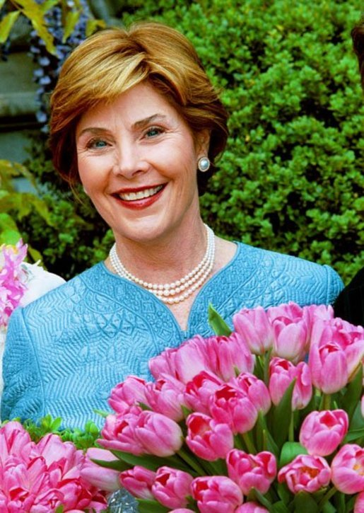 "Laura Bush poses with the newly-named ""Tulipa Laura Bush"" April 22, 2004. Earlier in the day, Mrs. Bush participated in an official naming ceremony at the Washington, D.C., residence of the Dutch Ambassador. White House photo by Tina Hager."