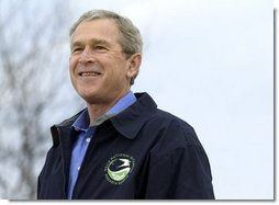 "President George W. Bush smiles during his introduction before delivering remarks on Earth Day at Wells National Estuarine Research Reserve in Wells, Maine, Thursday, April 22, 2004. ""The importance about Earth Day is that it reminds us that we can't take the natural wonders for granted. That's what Earth Day says to me, and I hope it says to you, as well, that we have responsibilities to the natural world to conserve that which we have and to make it even better,"" said the President in his remarks.  White House photo by Eric Draper"