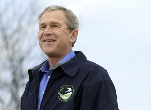 "President George W. Bush smiles during his introduction before delivering remarks on Earth Day at Wells National Estuarine Research Reserve in Wells, Maine, Thursday, April 22, 2004. ""The importance about Earth Day is that it reminds us that we can't take the natural wonders for granted. That's what Earth Day says to me, and I hope it says to you, as well, that we have responsibilities to the natural world to conserve that which we have and to make it even better,"" said the President in his remarks. White House photo by Eric Draper."