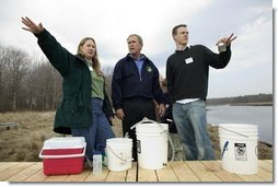 "President George W. Bush participates in a water testing project with Education Director Laura Lubelczyk, left, and volunteer Trak Lord at the Wells National Estuarine Research Reserve with in Wells, Maine, Thursday, April 22, 2004. In his remarks, President Bush discussed the value of volunteering in places like the reserve, ""But what makes this beautiful part of the world go is the 400 volunteers who work here -- the 400 volunteers who are exercising their responsibility as citizens to make this beautiful part of the world even more beautiful and more meaningful.""  White House photo by Eric Draper"