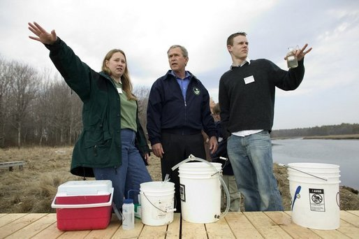 "President George W. Bush participates in a water testing project with Education Director Laura Lubelczyk, left, and volunteer Trak Lord at the Wells National Estuarine Research Reserve with in Wells, Maine, Thursday, April 22, 2004. In his remarks, President Bush discussed the value of volunteering in places like the reserve, ""But what makes this beautiful part of the world go is the 400 volunteers who work here -- the 400 volunteers who are exercising their responsibility as citizens to make this beautiful part of the world even more beautiful and more meaningful."" White House photo by Eric Draper."