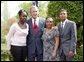 President George W. Bush congratulates the Groundwork Providence Environmental Team of Providence, R.I., on receiving the President's Environmental Youth Award in the East Garden April 22, 2004. Members of the team include, from left to right, Olabisi Davies, 17, Taja Gonsalves, 15, and Miguel Blanco, 16. White House photo by Susan Sterner.
