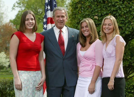 President George W. Bush congratulates, from left to right, Emily Slayton, 19, Jessica Herbrand, 19, and Kristin Fitzer, 19, of the Eatonville High School Salmon Enhancement Group of Eatonville, Wash., on receiving the President's Environmental Youth Award in the East Garden April 22, 2004. White House photo by Susan Sterner.