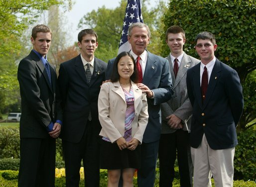 President George W. Bush congratulates the 4-H Adopt-A-Stream Club of Newnan, Ga., on receiving the President's Environmental Youth Award in the East Garden April 22, 2004. White House photo by Susan Sterner.