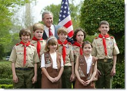 President George W. Bush congratulates the Dodge Elementary Scouts for Wetland Habitat Enhancement of East Amherst, N.Y., on receiving the President's Environmental Youth Award in the East Garden April 22, 2004.  White House photo by Susan Sterner